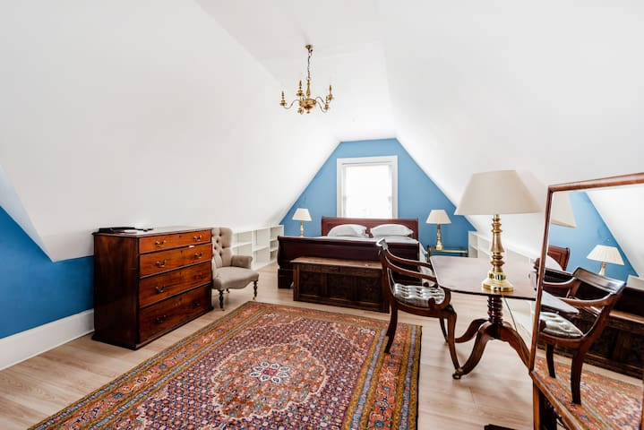 Bedroom 2, on the 2nd floor, is large and has two beds: a king (shown here) and a double. Two sash windows give light and a through breeze.