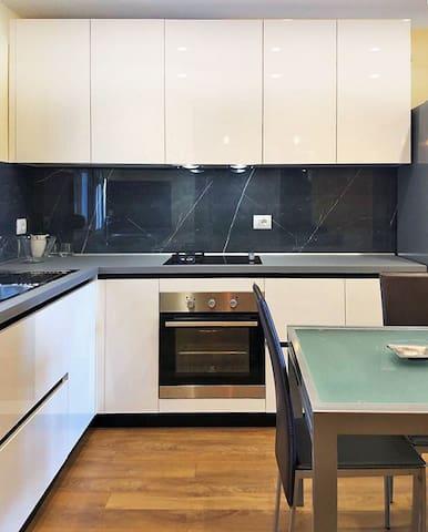 Kitchen  Area Italian kitchen with marble backsplash and and Italian furnishing.