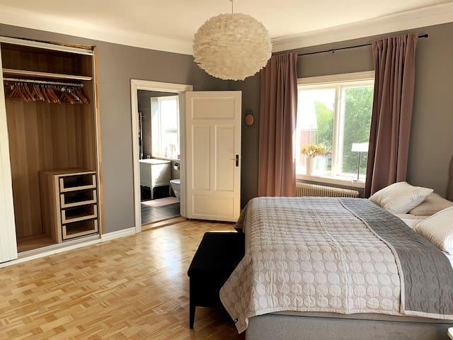 Master bedroom 2nd floor with king-size bed, en-suite bathroom