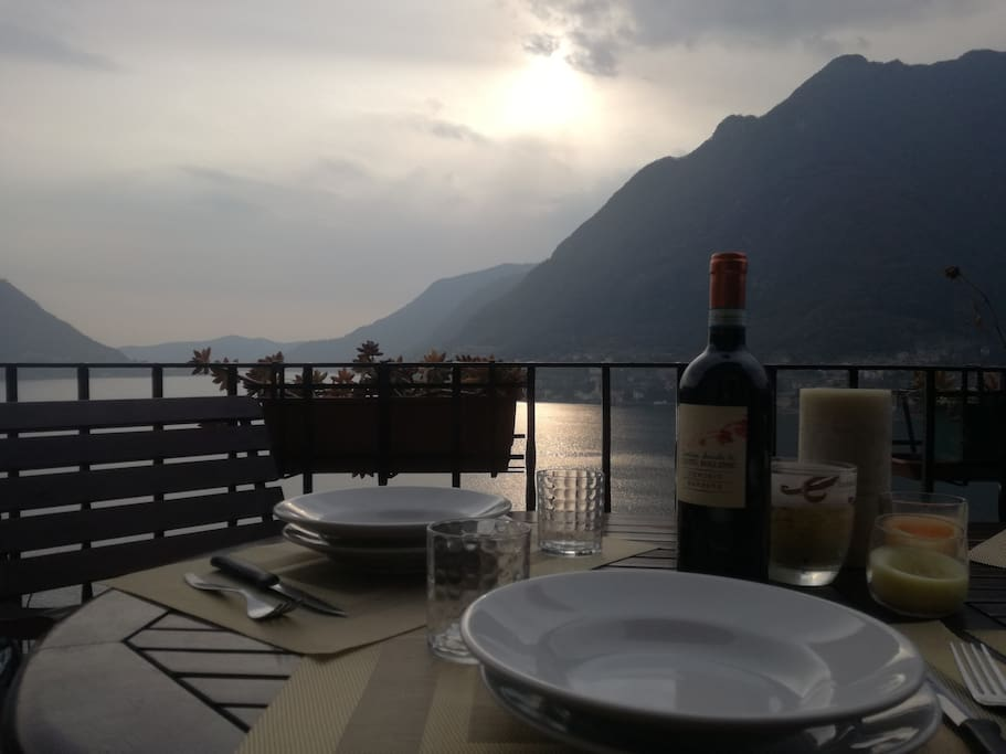 Enjoy a dinner on the terrace, at the sunset, with the amazing view on our lake and our mountains!