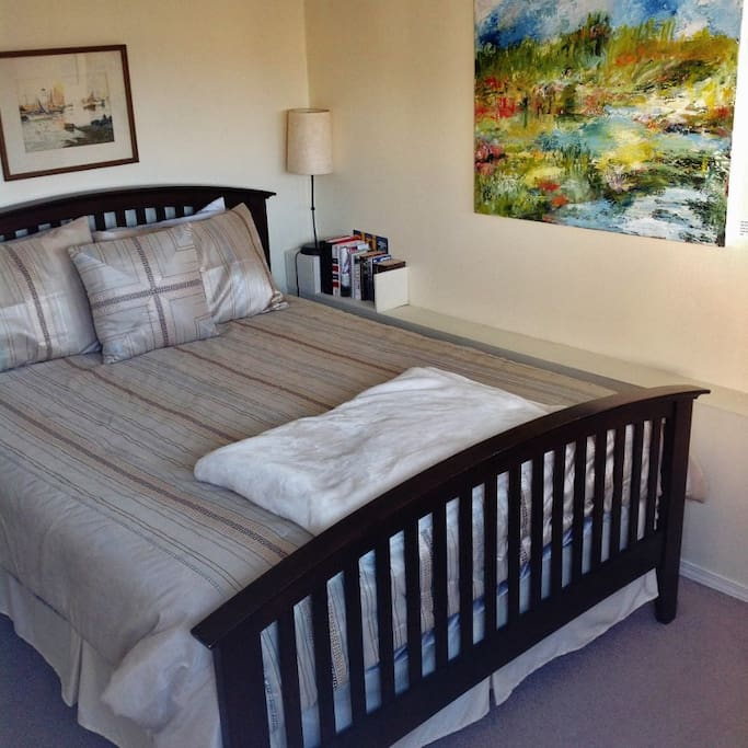 Your bedroom with painting by local artist Mary Patricia Deveau