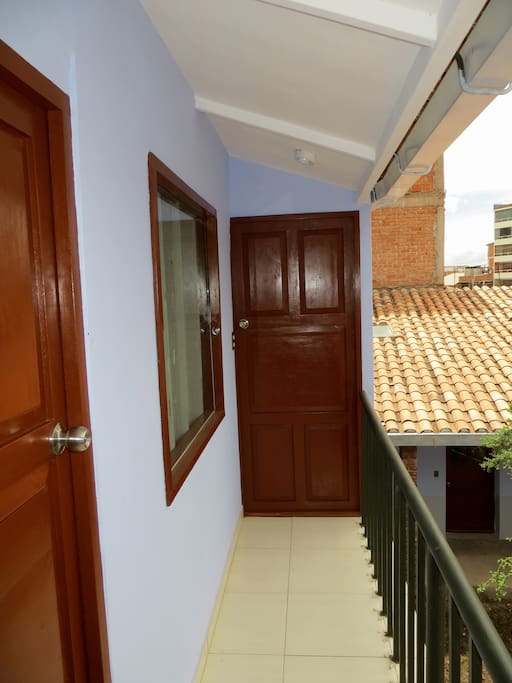 This short (5m) balcony gives you view over the interior patio and connects you to the common room and bathroom.