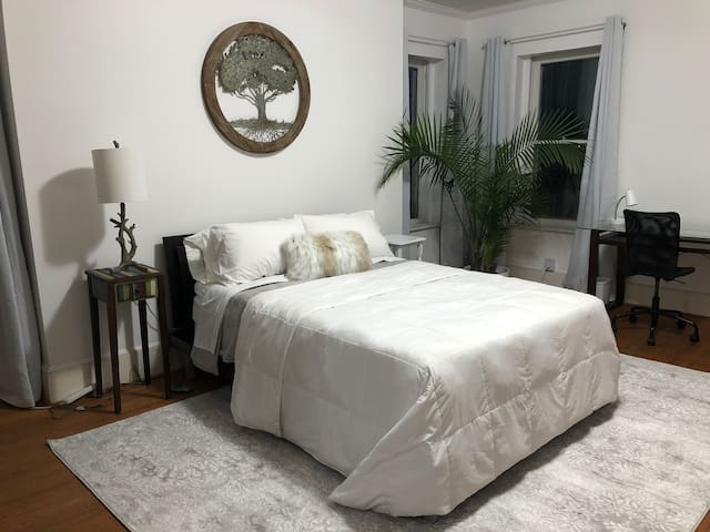 900 square foot bedroom and sitting room with tall ceilings and wood floors!   This is a low VOC Avocado brand mattress with natural mattress topper from avocado.  Extremely comfortable!