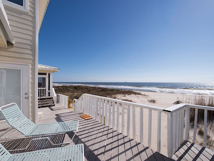 Get some sun on the back deck with a view of the white sand beach.