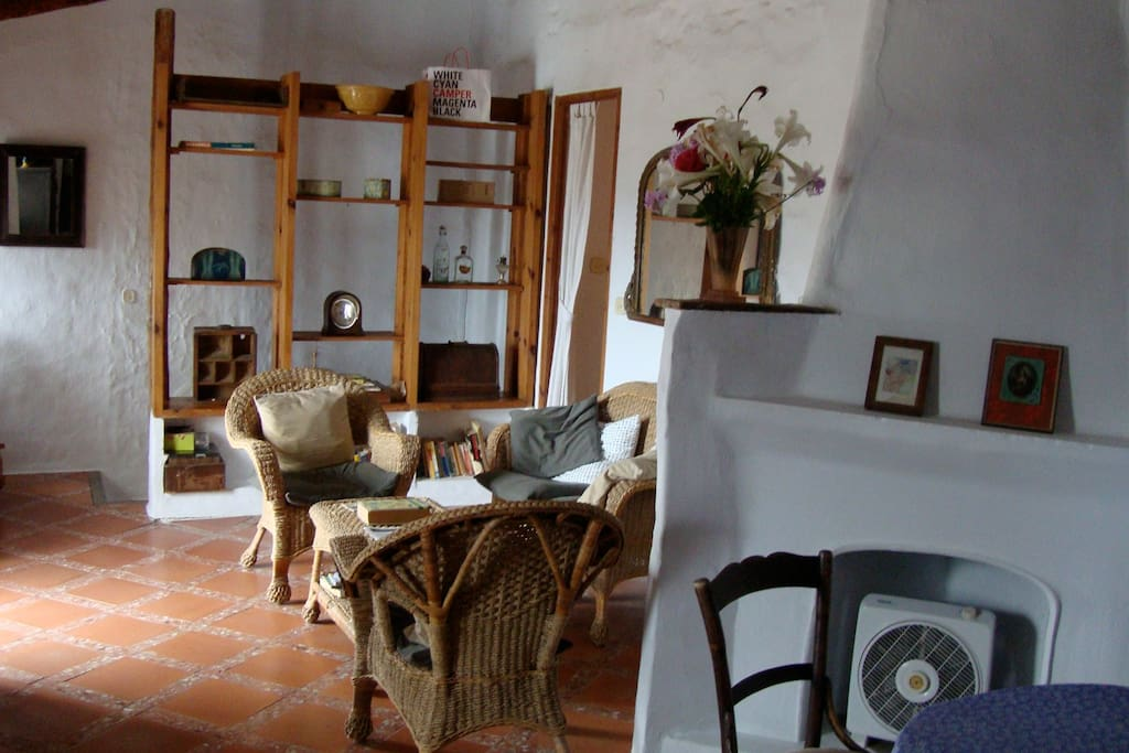 The living room has wonderful light throughout the day and the decor has been curated by Penelope over the past 45 years of owning her home. Not featured in this photo, is the balcony that overlooks the street and has a view over the town of Frigiliana.