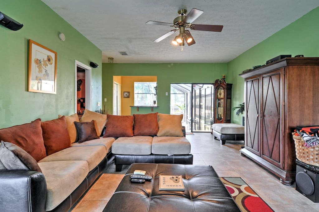 Plenty of comfortable seating for everyone in this home's vibrant interior.