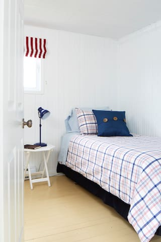 Bedroom with 2 single beds. Only one bed is visible but there are two!