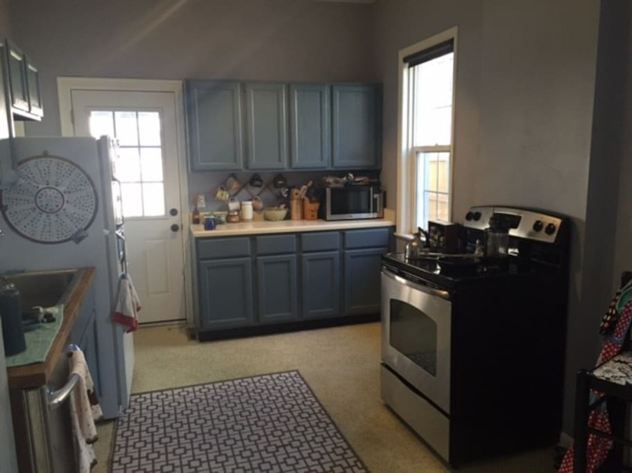 Full size kitchen with stove, refrigerator, and dishwasher