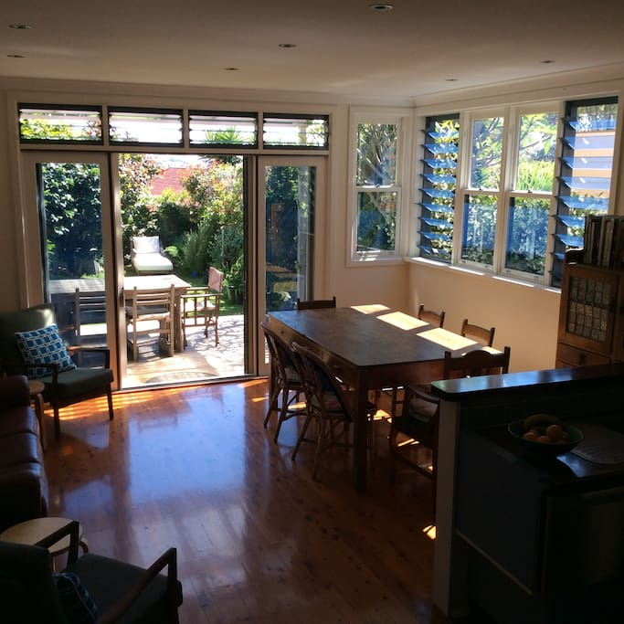 Open plan kitchen and dining room stepping onto covered deck.