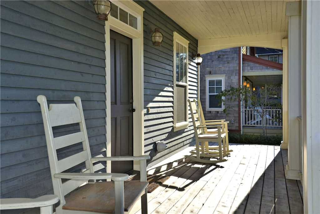 Front porch with four rocking chairs to enjoy the ocean breeze