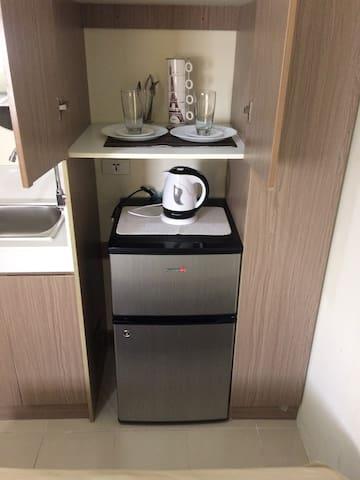 Cozy affordable new condo along EDSA, near MRT