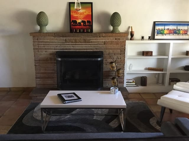 Spacious Addison's House featuring cozy living room with fireplace