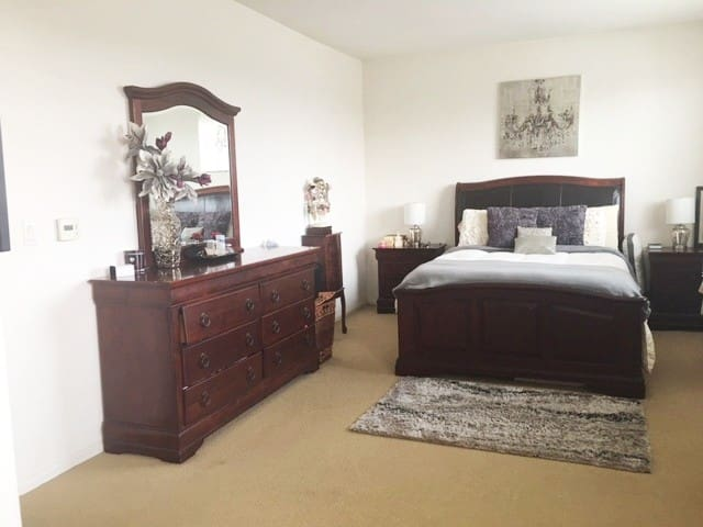 Master bedroom with queen size bed and walk in closet. (personal items have been removed)