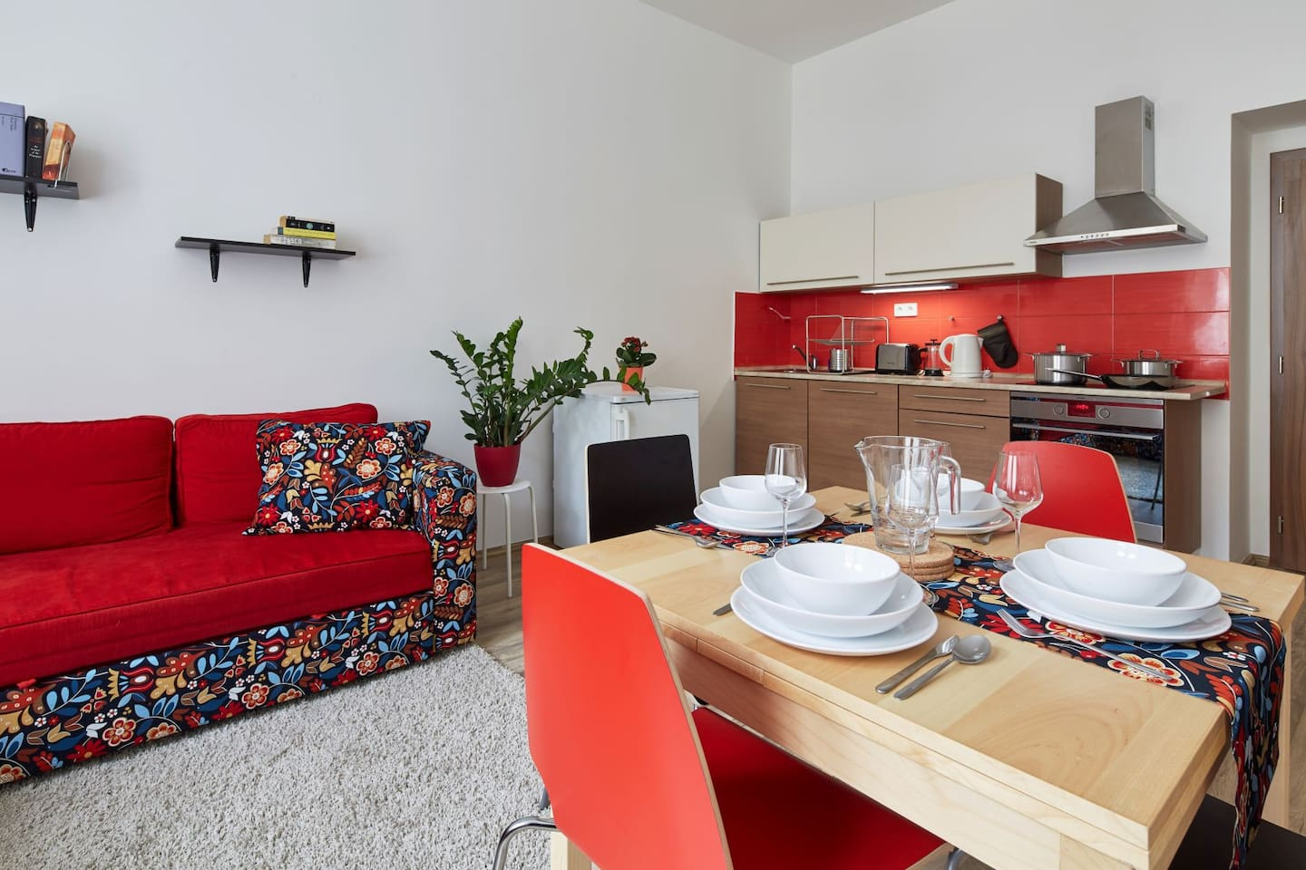 There is a fully equipped kitchen with everything you might need to prepare any meal, including a toaster and oven.