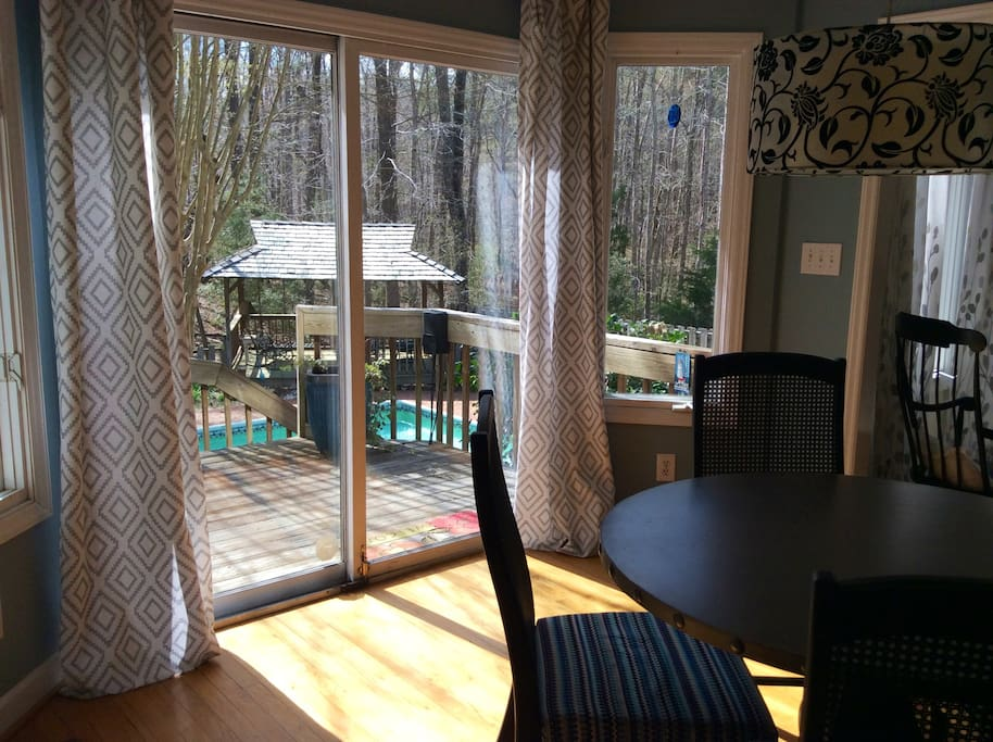 View of full sized pool, gazebo, and acres of woods.  Lovely quiet neighborhood 10 minutes from UNC