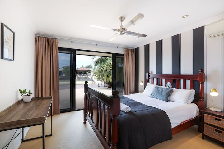 Air conditioned master bedroom with full canal views and direct access to the large entertaining deck. Private en suite with toilet, double vanity and large shower. Huge WIR.