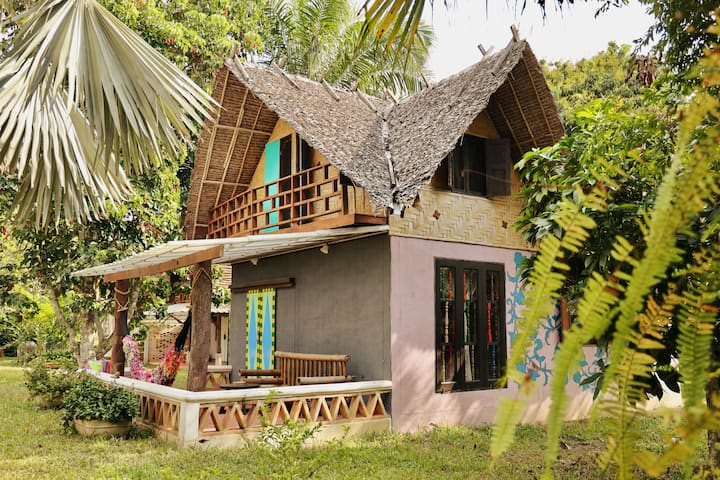 Private bungalow in tropical garden with pool
