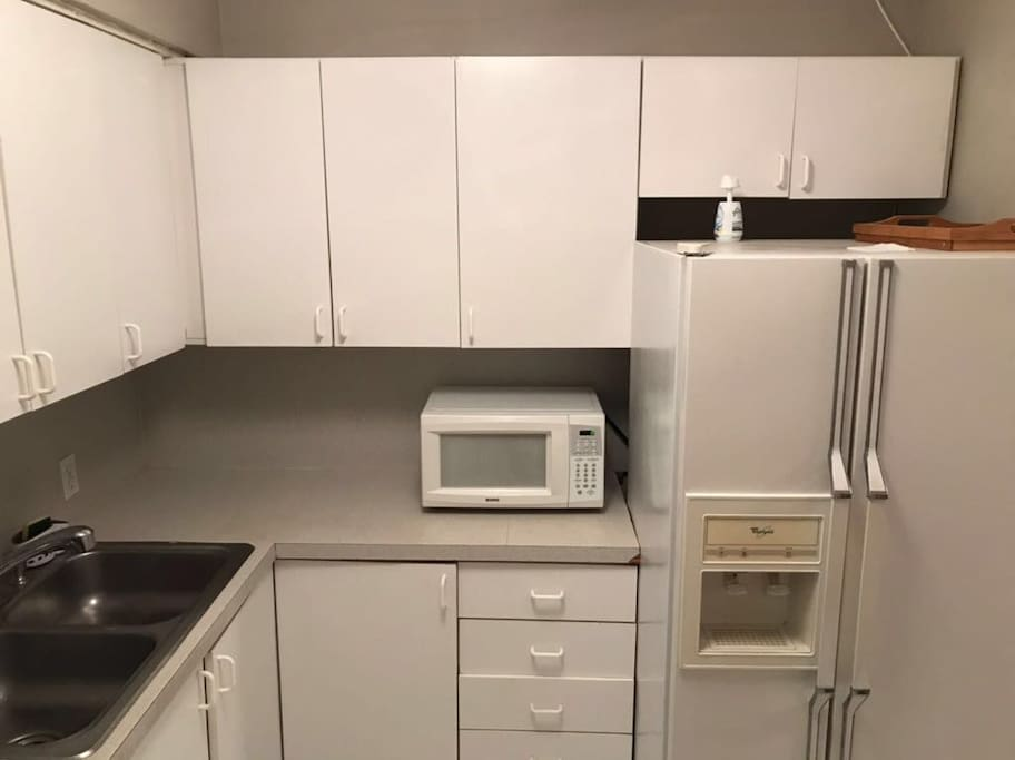There are Microwave, stove, refrigerator,  coffee maker, toaster, air fry and dishes.