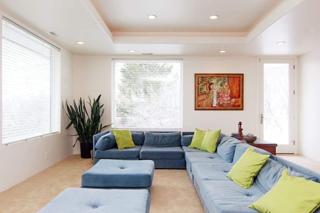 Large, comfortable living area with patios on east and west sides.