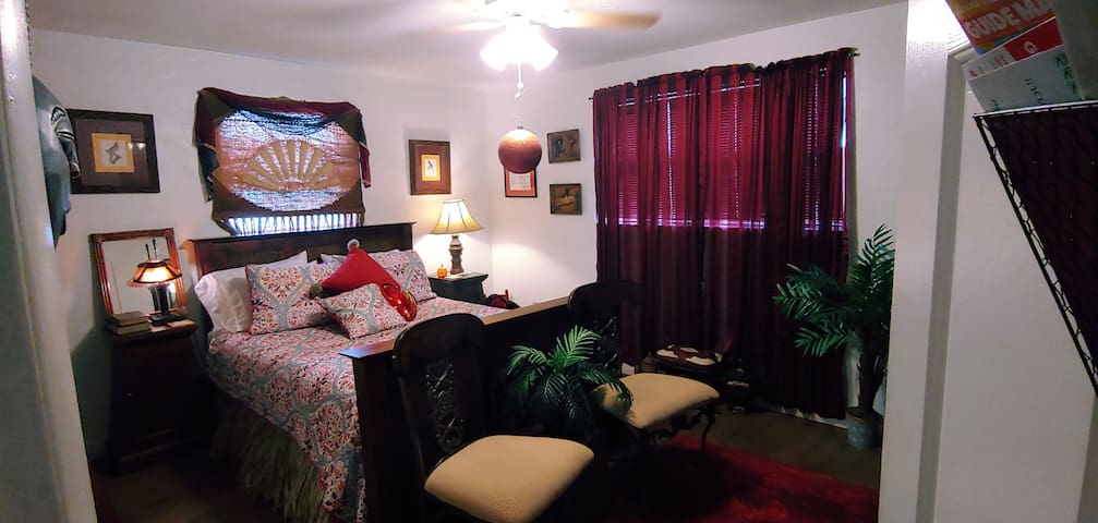 Beautiful red room warm and inviting memory foam queen size bed refrigerator ceiling fan 44 inch flat screen TV Wi-Fi ready for streaming