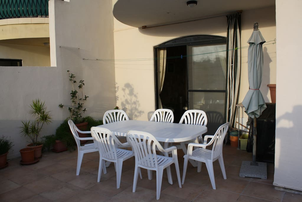 Sunny balcony with table and chairs
