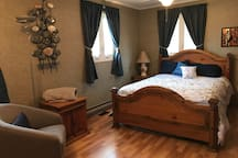 Upstairs master bedroom with a queen bed