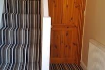 Hallway and door leading to shower room
