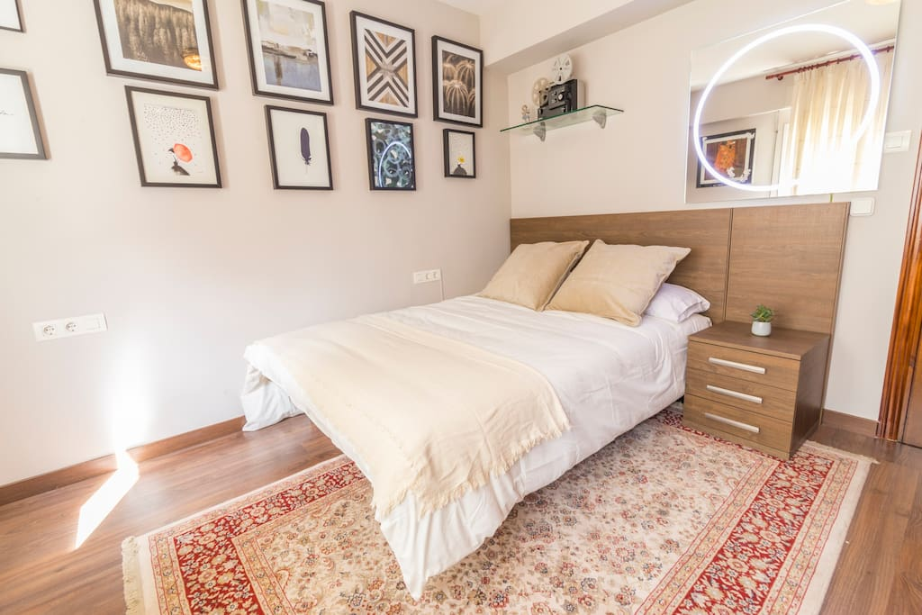 Nice and comfortable bedroom with a cool carpet!