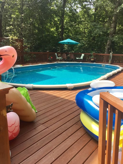Above ground pool with deck and floats.  Swim towels available.
