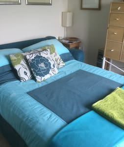 Light, airy room with comfortable double sofa bed.