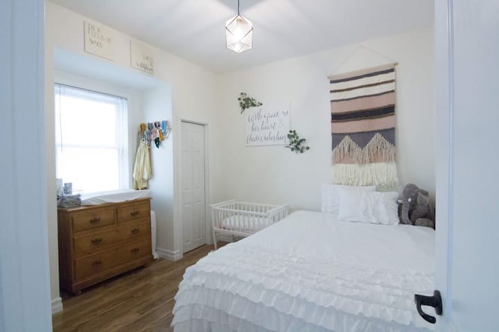 Guest room with Queen bed and crib.