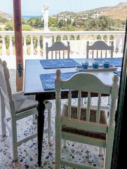 As it is evident from the photos, there is a big beautiful garden that surrounds the house. You will be able to enjoy your meal at the big table positioned at the balcony of the house, with a view to the sea.