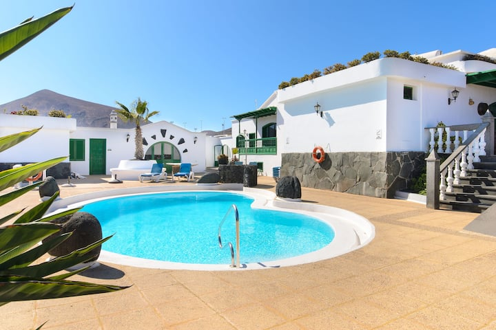 Beautiful Apartment Lanzarote with Heated Pool, Terrace, Mountain/Ocean Views & Wi-Fi; Parking Available