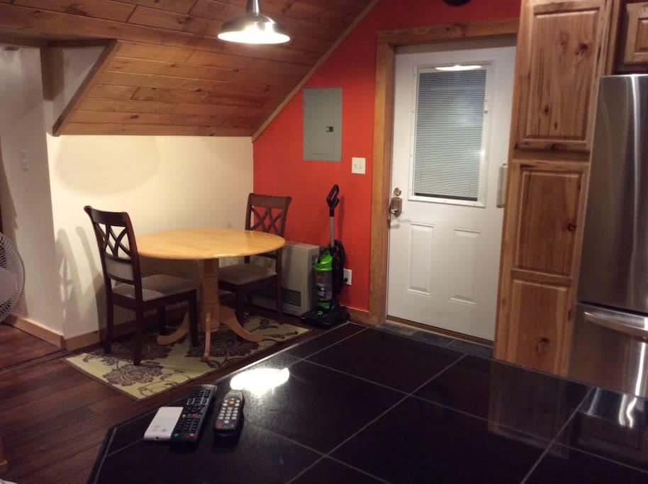 Dining area, door leads to 2nd floor deck overlooking private yard