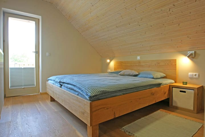 ROOM4 - Double bed with TV and balcony.