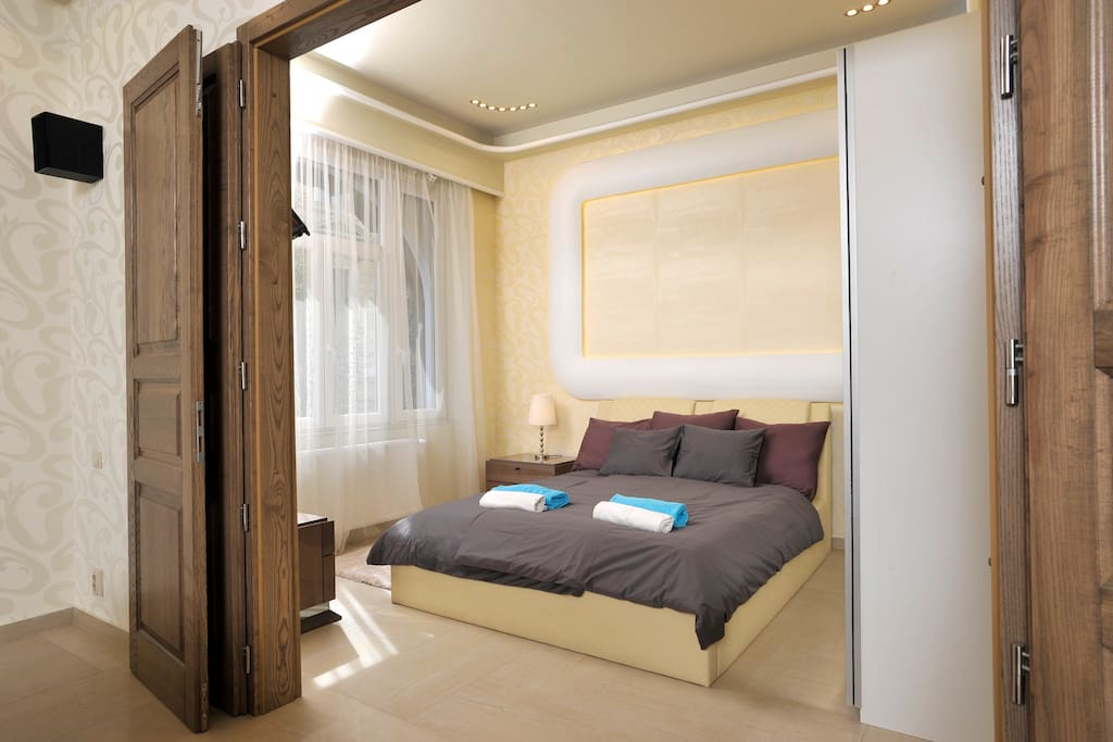 The first bedroom with its windows facing the prestigious October 6 walking street.