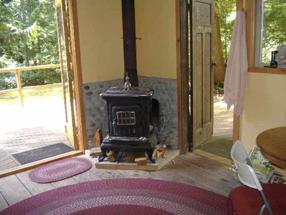 CSA approved wood fireplace in well-insulated cabin.