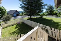 Fenced in yard off the Sunroom