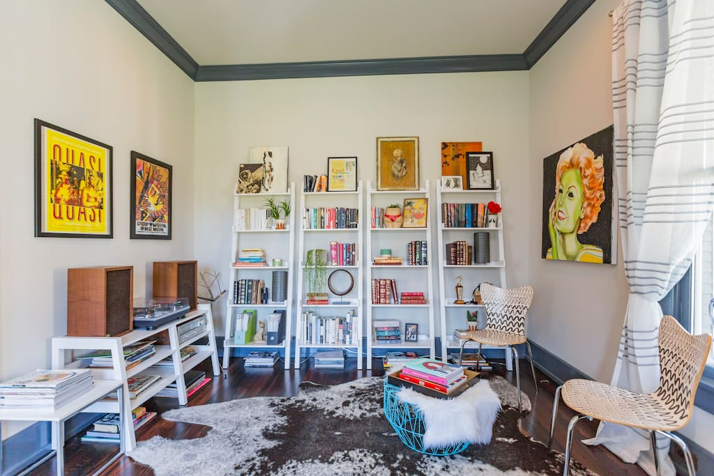 Welcome! This is the first thing you'll see when you walk in, my entry way with books, records, art, and a piano!