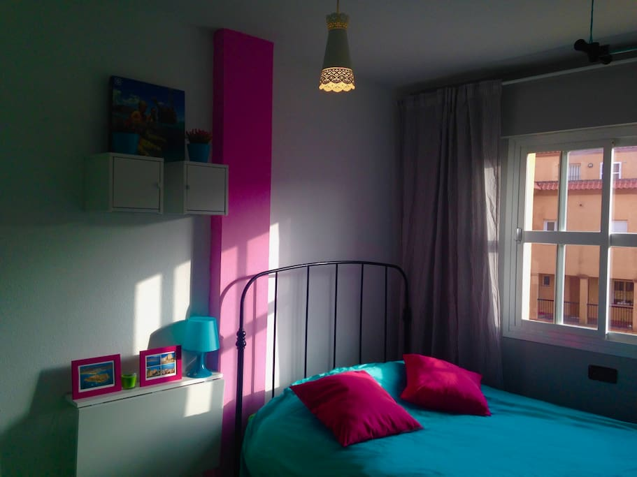 double bed in light room