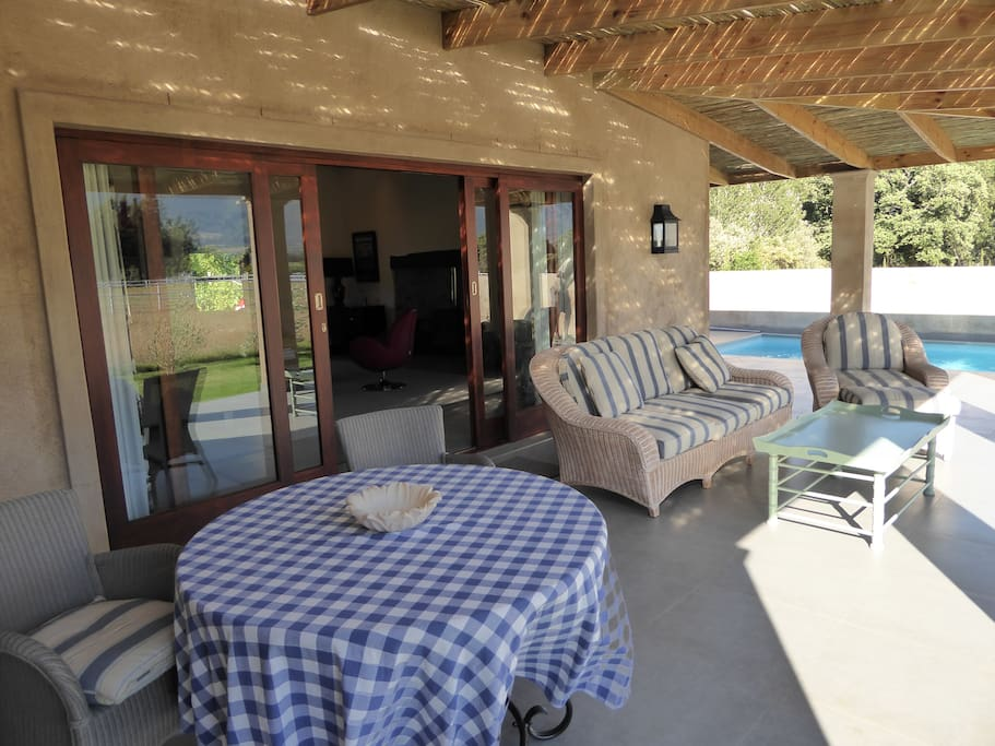 The shaded veranda and the pool