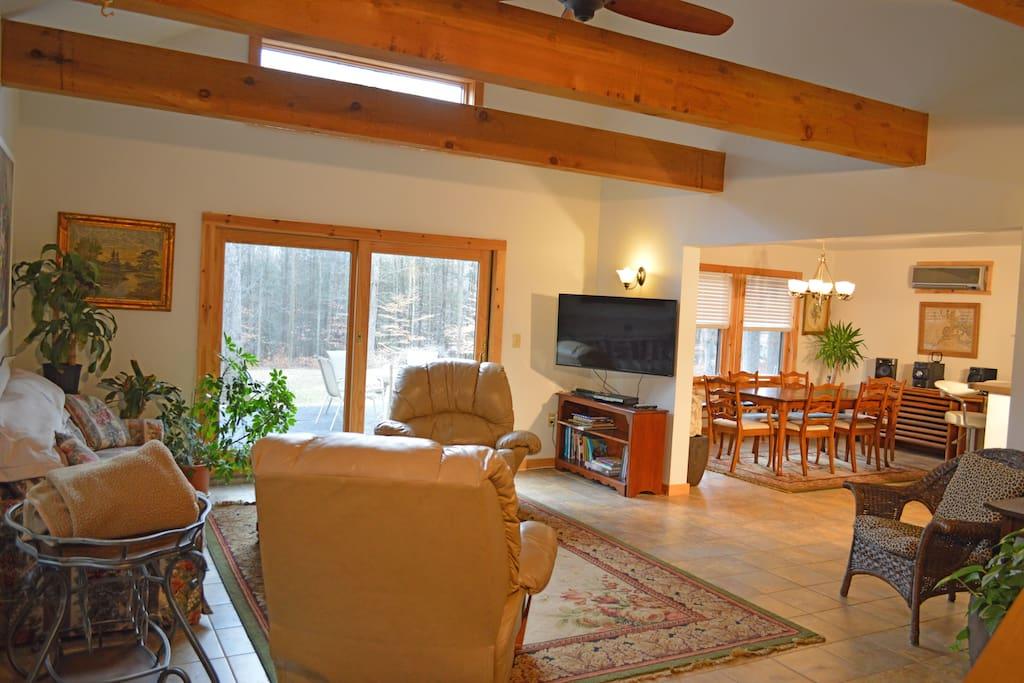 Welcome to Hidden Cedar Inn's East Wing Living Room, Meeting Room, & Patio view.