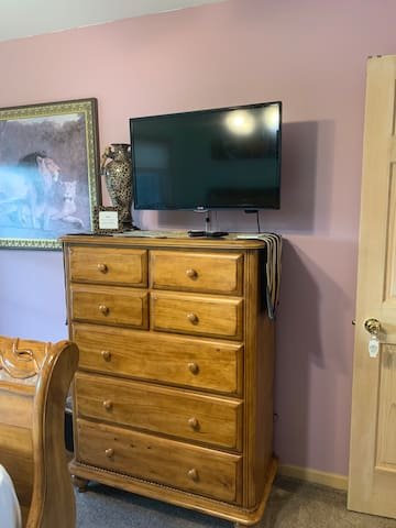 Cable TV above chest of drawers for your use