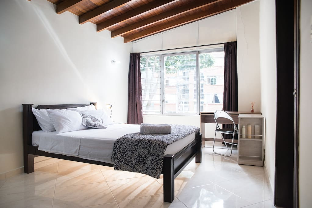Your bedroom: Double bed, closet, desk/workspace, night stand, lamp, towels, blankets, soap, shampoo, conditioner