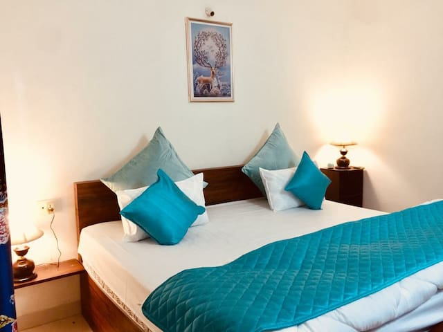 Master bedroom with lovely night lamps and relaxation looking over to mangrove forest and Nerul river