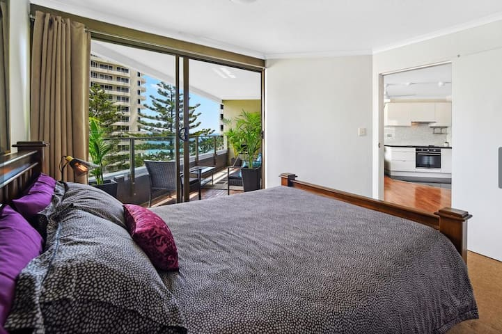 The master's bedroom has easy access to the balcony and offering an abundance of natural light from the outside.
