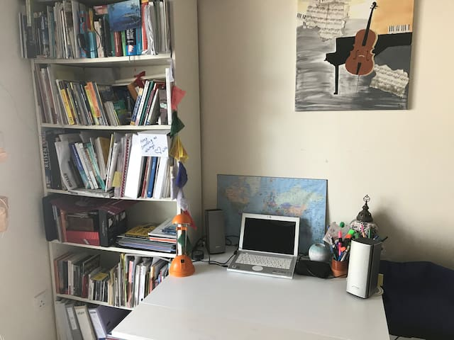 This is  the work station and my library with books about Dubai, UAE and the Middle East - they are yours for the length of your stay...