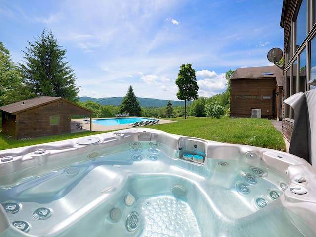 Outdoor hot tub is great all year round with amazing views! Right outside the guest house.