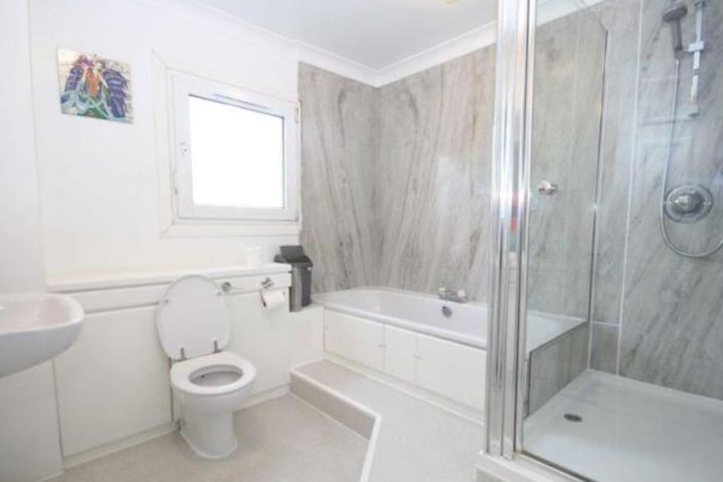 marble bathroom with seperate shower