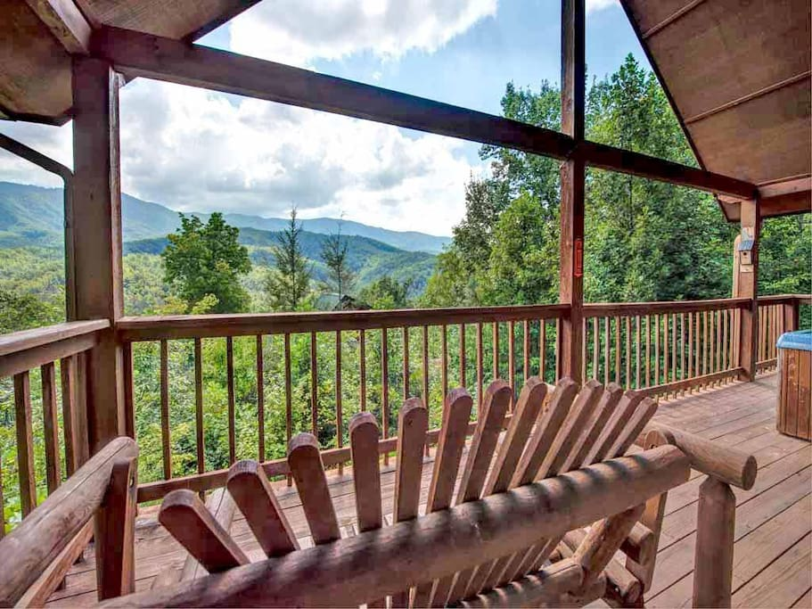 Romance in the mountains - Start your day by admiring the sunrise over the mountains from the loveseat rocker on the deck, or end
